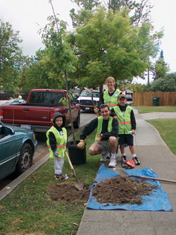 Family planting tree at a CityTrees event