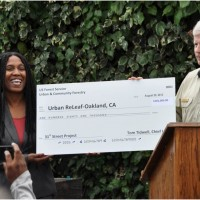 emba Shakur, Executive Director of Urban Releaf, accepts a check from USDA Forest Service Chief Tom Tidwell.