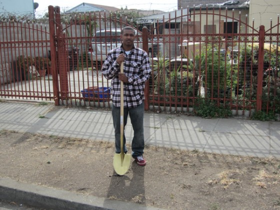 A volunteer for Urban ReLeaf poses before he started digging.
